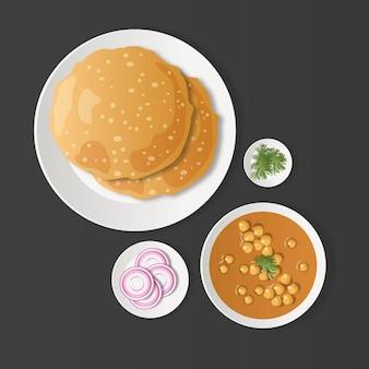 スライスした玉ねぎとコリアンダーの葉とインドの伝統的な朝食チョーレーバトゥーラ