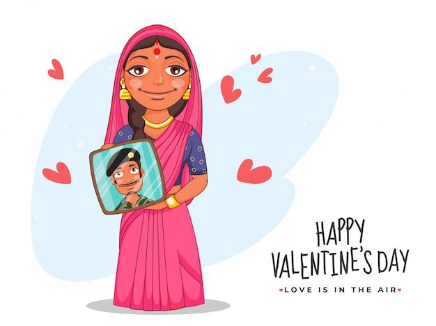 해피 발렌타인의 날에 붉은 마음으로 그녀의 남편 사진 프레임을 보여주는 인도 여자, 사랑은 공기에있다.