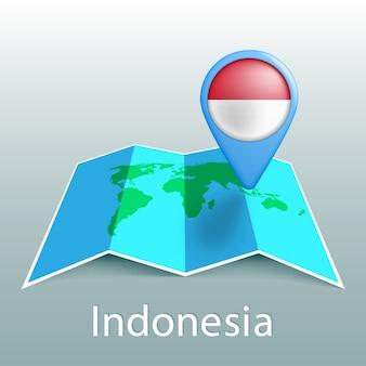 灰色の背景に国の名前とピンでインドネシアの旗の世界地図