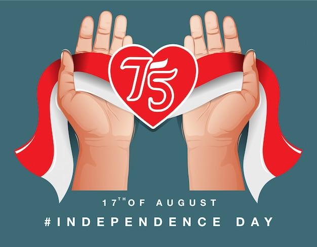 インドネシア独立記念日。インドネシアの国旗を持っている手のイラスト。