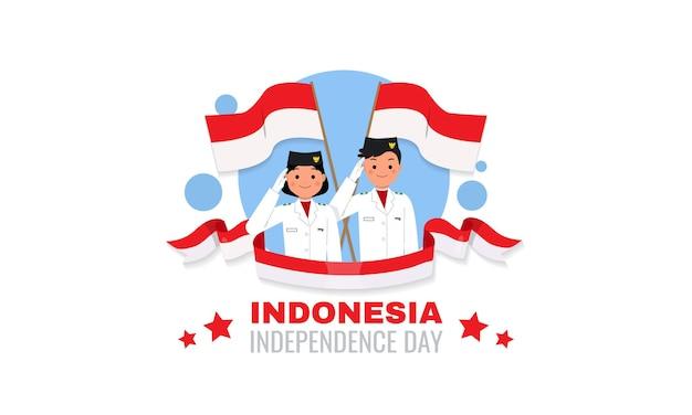 インドネシアの男の子と女の子がインドネシアの独立記念日のお祝いの日に敬礼するために手を上げる