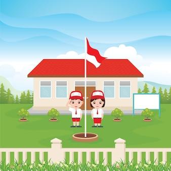 2人の子供と緑の庭の旗を持つインドネシアの小学校