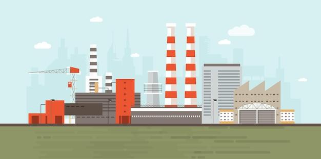 도시 스카이 라인을 배경으로 공장 건물이있는 산업 단지 또는 구역