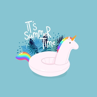 Inflatable unicorn surrounded by tropical leaves with lettering it's summer time on the blue background