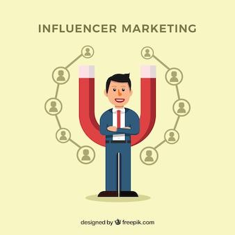 Influenza del concetto di marketing con uomo d'affari e magnete