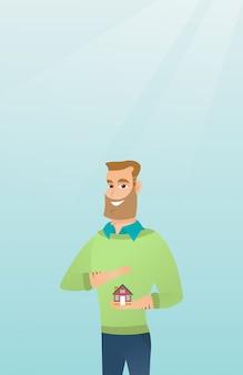 住宅の模型を保護する保険代理店。