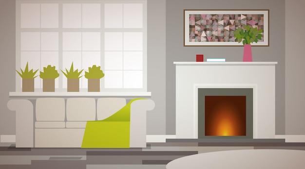 ベージュを基調にした民家のインテリア。暖炉は火を燃やす。緑のある大きな窓。大型の柔らかいソファ