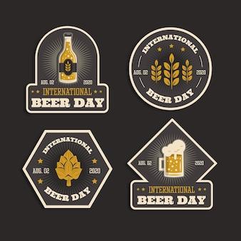 Design piatto per il giorno della birra internazionale distintivi