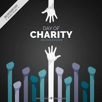 International charity day with raised hands