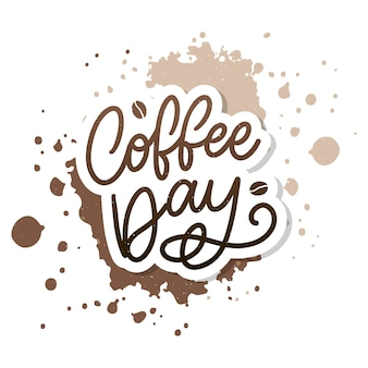 International coffee day lettering with coffee beans.