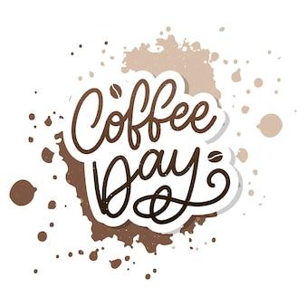 커피 원두와 함께 국제 커피 데이 레터링.