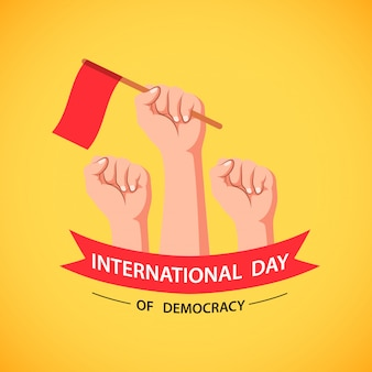 International day of democracy with hand holding flag.