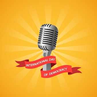 International day of democracy with microphone and ribbon.