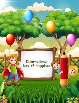 International day of happiness sign with cheerful kids on nature