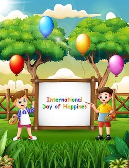 幸せな男の子の絵と国際幸福デーのサイン