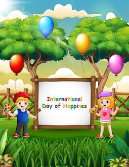 幸せな子供たちの絵と国際幸福デーのサイン