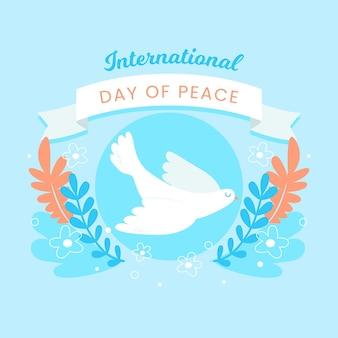 Международный день мира с листьями и голубем