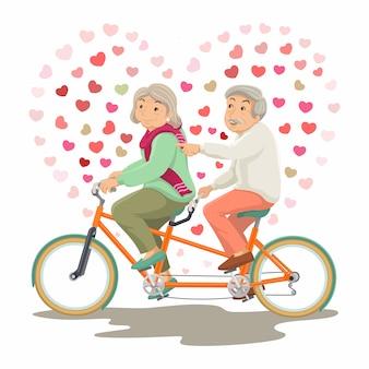국제 노인의 날. 할아버지와 할머니가 함께 탠덤 자전거를 타고