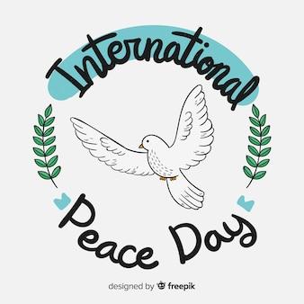 Iscrizione disegnata a mano di giorno internazionale di pace composizione