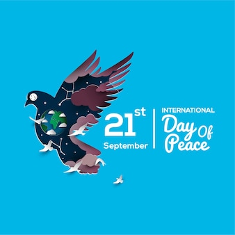 International day of peace papercut style greeting card with dove and globe