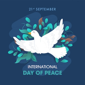 International day of peace text with dove flying and olive leaves decorated on blue background .