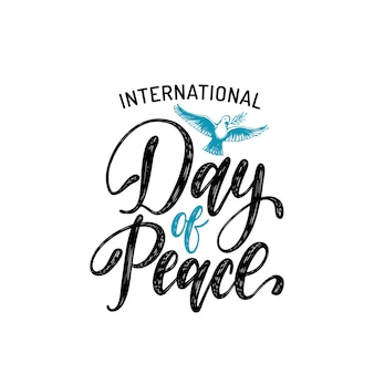 International day of peace, vector hand lettering. drawn illustration of dove with a palm branch on white background. holiday card, poster with calligraphy.