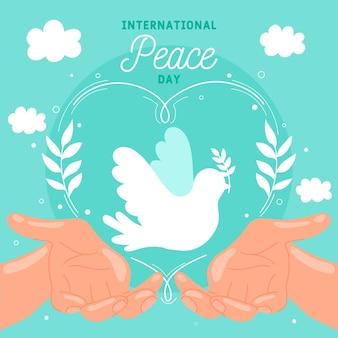 Giornata internazionale della pace con colomba e mani