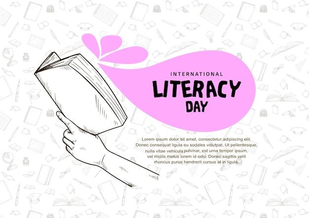 흰색 배경에 고립 된 책을 들고 손으로 국제 문맹 퇴치의 날