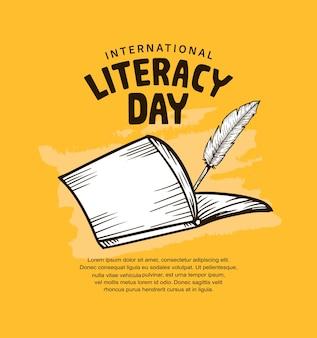 열린 책과 깃털 펜이 노란색 배경에 격리된 국제 문맹 퇴치의 날