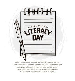 흰색 배경에 격리된 펜과 노트북이 있는 국제 문맹 퇴치의 날