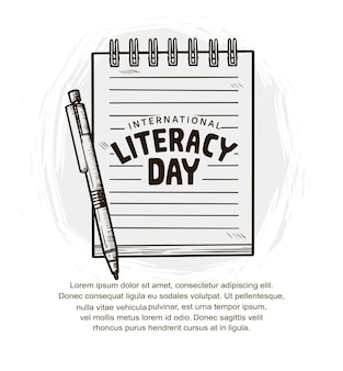 International literacy day with pen and notebook isolated on white background