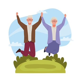 International older persons day with old couple jumping in the field