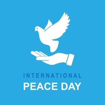 Баннер международного дня мира. голубь в руках с текстом «международный день мира». векторная иллюстрация. eps 10