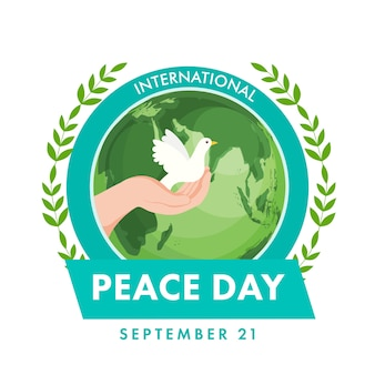 International peace day concept with human hand holding dove, olive leaves and earth globe on white background.