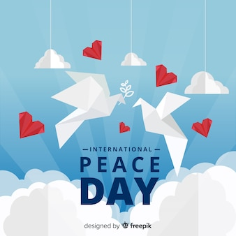 International peace day concept with white dove in origami style