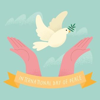 비둘기와 함께 국제 평화의 날 포스터