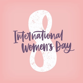 International women's day hand lettering against figure eight on pink
