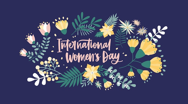 International women's day lettering handwritten with calligraphic font and surrounded by spring flowers and inflorescences