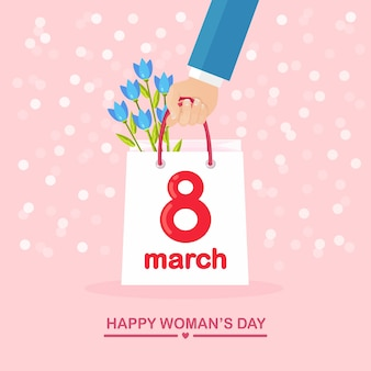 International women's day. purchase in shopping bag, flower bouquet and gift boxes