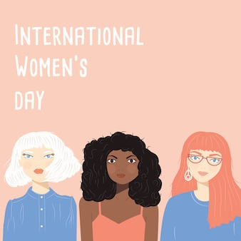 International women's day sign with portraits of three diverse women