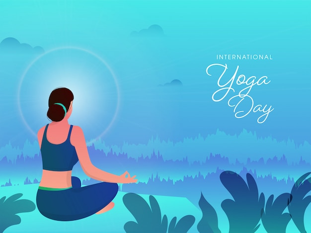 International yoga day font with back view of young woman sitting in meditation pose on gradient blue abstract nature background.