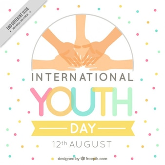 International youth day background with hands and colored spots