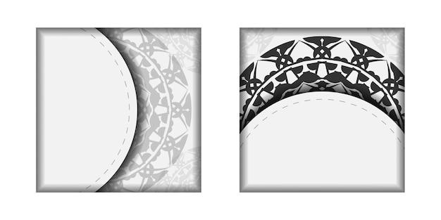 あなたのテキストとギリシャの装飾品のためのスペースを備えた招待状のデザイン。はがきのデザイン黒の曼荼羅模様の白い色。