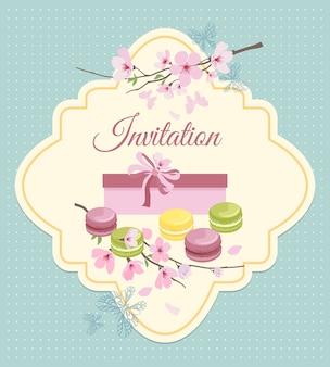 ヴィンテージのノスタルジックなスタイルの花とフレンチマカロンのティーパーティーへの招待状。