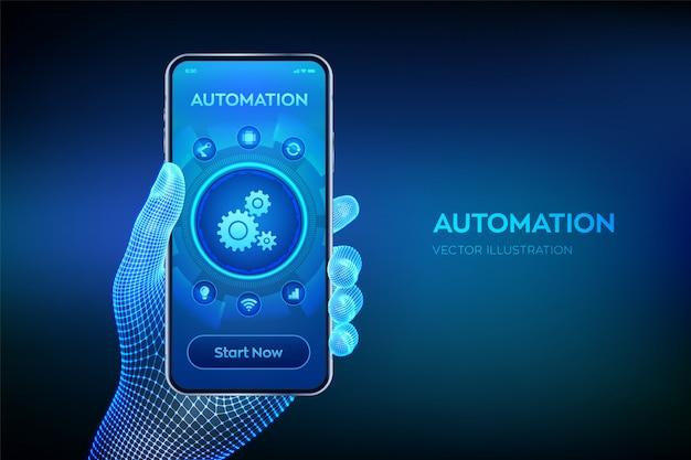 Программное обеспечение для автоматизации. iot и концепция автоматизации. крупным планом смартфон в каркасной руке.