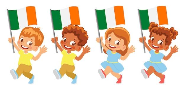 Ireland flag in hand. children holding flag. national flag of ireland