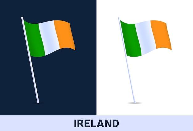 Флаг ирландии. развевающийся национальный флаг италии, изолированные на белом и темном фоне. официальные цвета и пропорции флага. иллюстрация.
