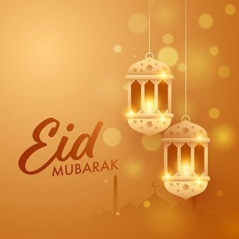 Islamic festival eid-al-fitr mubarak concept with hanging golden arabic lanterns, mosque silhouette