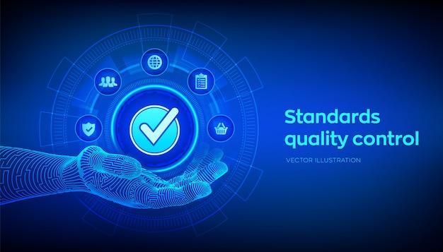 Контроль качества стандартов iso. принятый знак в роботизированной руке.