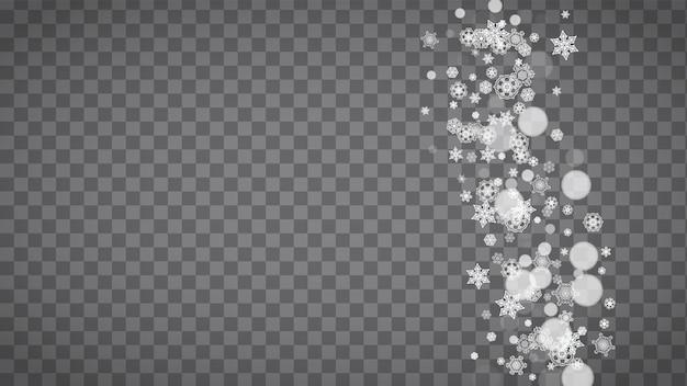 透明な灰色の背景に孤立した雪片。冬のセール、パーティーの招待状、バナー、セールのクリスマスと新年のデザイン。水平の冬の窓。魔法の孤立した雪片。シルバーフレーク